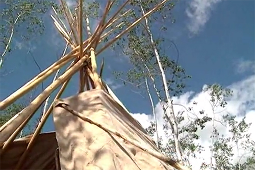 Top of a tipi with intersecting poles
